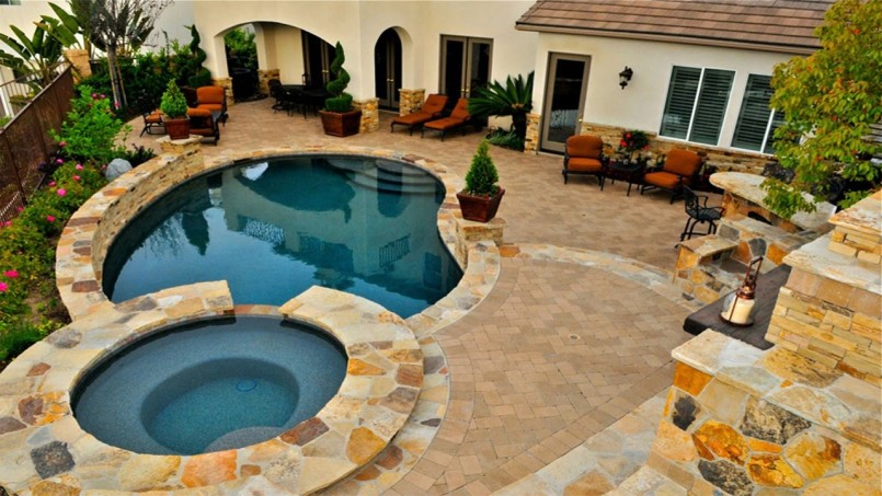 Underground Swimming Pools | Poolside Fireplace | Backyard Pool Designs